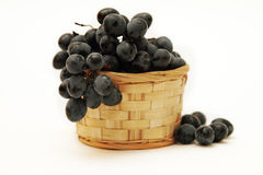 Grape branch in a basket Royalty Free Stock Photo