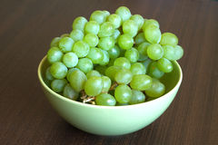 Grape in branch in green bowl close up Royalty Free Stock Photography
