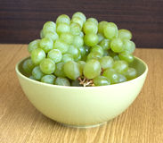 Grape in branch in green bowl close up Royalty Free Stock Photo