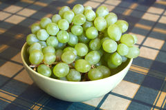 Grape on branch in green bowl closeup Royalty Free Stock Photography