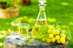 Grape brandy with fresh grapes Royalty Free Stock Photo
