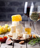 Grape, cheese, figs and honey with a glasses wine. Royalty Free Stock Images
