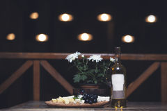 Grape, cheese, figs and honey with a white wine Stock Image