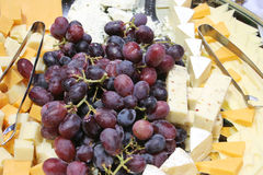 Grape cheese platter. Lovely Platter with grapes and cheeses Royalty Free Stock Photo
