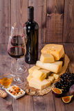 Grape and cheese variety with a red wine Stock Photos