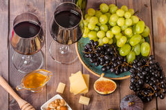 Grape and cheese variety with a red wine Royalty Free Stock Images
