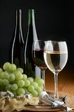 Grape, cheese and wine. On the black background Royalty Free Stock Image