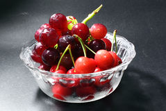 Grape and cherry Stock Image