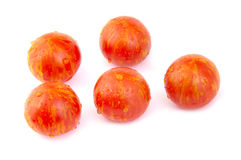 Grape or cherry tomatoes on white background Royalty Free Stock Image