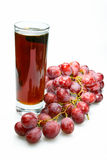 Grape cluster and juice in glass Royalty Free Stock Photos