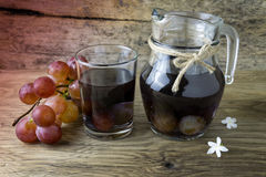 Grape compote in a jar on a wooden table Royalty Free Stock Photo
