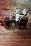 Grape compote in a jar on a wooden table Royalty Free Stock Image