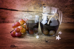 Grape compote in a jar on a wooden table Stock Image