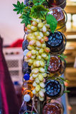 Grape on decorative column Royalty Free Stock Image