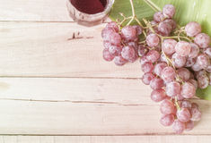 Grape on dry wood Stock Photos