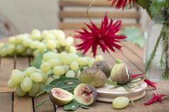 Grape and figs  on a wooden table Royalty Free Stock Photos