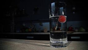 Grape floating in a glass with sparkling water stock video