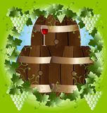 Grape frame and cask wine. In a green frame of the vine three barrels of wine and a glass of red wine Royalty Free Stock Photography