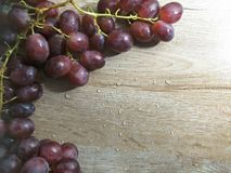 Grape on wooden table background stock photography