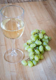 Grape fruits and white wine Stock Photography