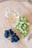 Grape fruits and wine Royalty Free Stock Image