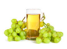 Grape and glass of juice on white Stock Photo