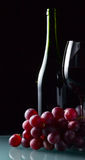 Grape and glass with red wine Stock Photo