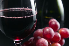 Grape and glass with red wine Royalty Free Stock Photography