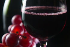 Grape and glass with red wine Royalty Free Stock Image