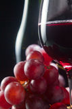 Grape and glass with red wine Royalty Free Stock Images