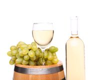 Grape, glass of wine on the barrel and bottle Stock Image
