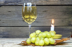 Grape with a glass of wine and candle Stock Photos