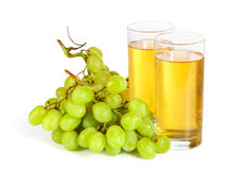 Grape and glasses of juice on white Royalty Free Stock Photo