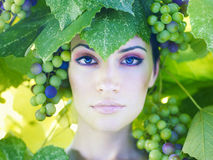 Grape goddess. Beautiful young lady wrapped in grape Stock Photography