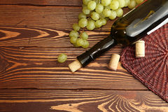 Grape green bunch with wine bottle Stock Images