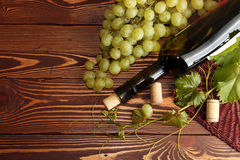 Grape green bunch with wine bottle Royalty Free Stock Photo
