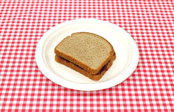 Grape jelly sandwich on picnic plate Royalty Free Stock Image