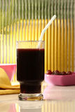 Grape juice. A glass of grape juice with grapes on background Stock Image