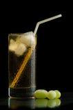 Grape juice. Glass of cold grape juice on a black background Stock Photos