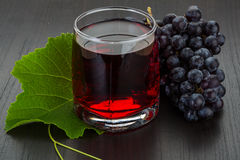 Grape juice and berries Royalty Free Stock Images