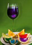 grape juice with colorful lemon on plate Royalty Free Stock Photos