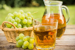 Grape juice in the glass Stock Photography