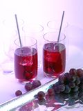 Grape juice in glasses Stock Images