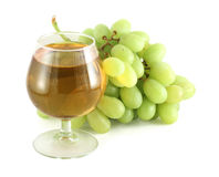 Grape juice with grapes. Grape juice in wine glass with grapes isolated on white Stock Image
