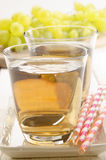 Grape juice and grapes in the background Royalty Free Stock Images