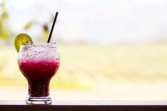 Grape juice with lime soda Royalty Free Stock Images