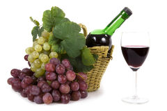 Grape with leaves and bottle of wine royalty free stock photo
