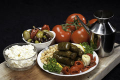 Grape leaves stuffed. Stuffed Grape leaves with feta cheese, olives and tomatoes Royalty Free Stock Photography