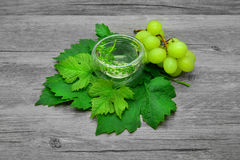 Grape leaves and white wine Royalty Free Stock Image
