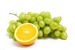 Grape and orange. Isolated on a white background Stock Photo